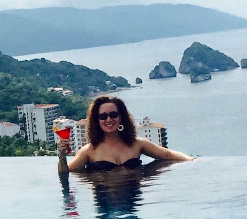 Autumn Murray in rooftop infinity pool at Hotel Mousai