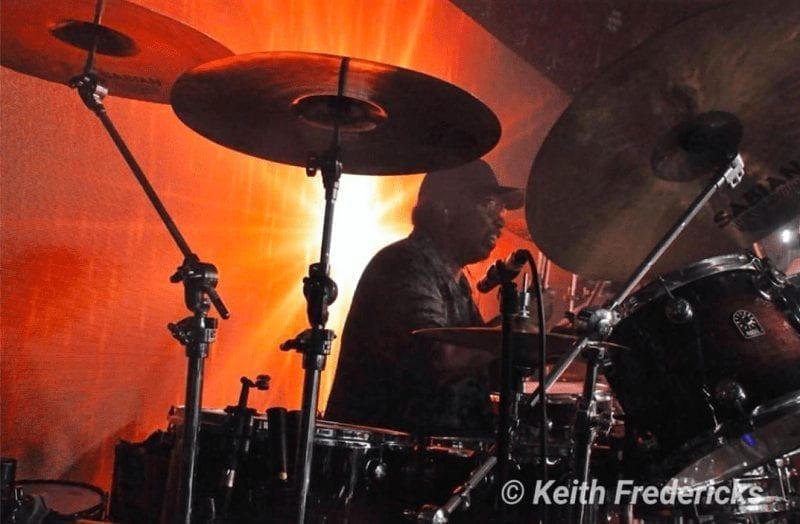 George Michael band member Trevor Murrell on the drums at Cowboys N Angels Concert