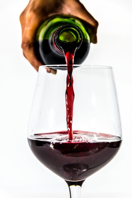 Wine pour stock image